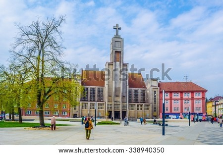 HRADEC KRALOVE, CZECH REPUBLIC, APRIL 30, 2015: people are passing by in front of the modern looking church of divine heart of lord (bozskeho srdce pane) - stock photo