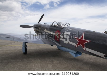 HRADEC KRALOVE, CZECH REPUBLIC - SEPTEMBER 5: World War II Soviet fighter Yakovlev Yak-3 on runway at the CIAF - Czech international air fest on September 5, 2015 in Hradec Kralove, Czech republic.