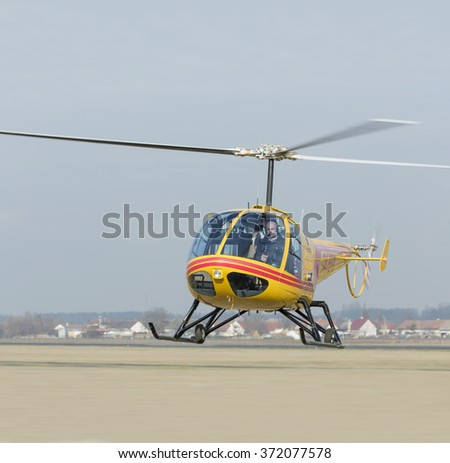 HRADEC KRALOVE - 29 JAN 2016: Helicopter rescue. Yellow helicopter in the air while flying on blue sky. CZECH REPUBLIC - stock photo
