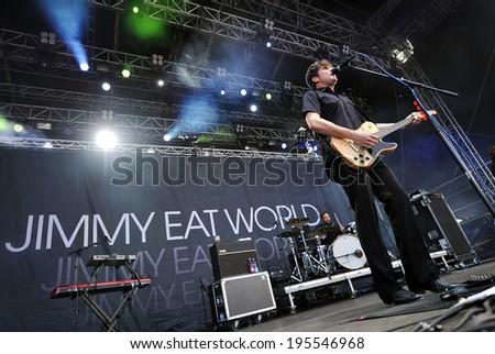HRADEC KRALOVE - JULY 5: Singer Jim Adkins of Jimmy Eat World during performance on festival Rock for People in Hradec Kralove, Czech republic, July 5, 2011. - stock photo