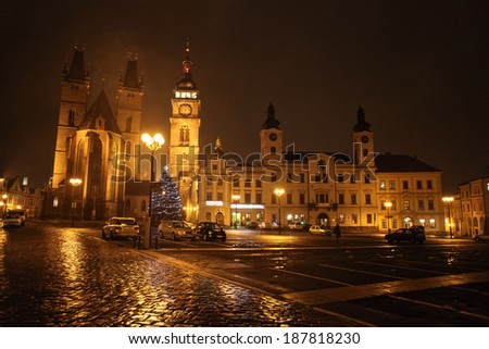 HRADEC KRALOVE, THE CZECH REPUBLIC - JANUARY 3, 2013: The Great Square of Hradec Kralove at night with Cathedral, Town Hall and other surrounding buildings. One unrecognizable person visible. - stock photo