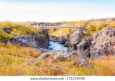 Hraunfossar, a very beautiful Icelandic waterfall in the western part of Iceland - stock photo