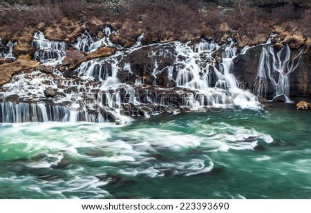 hraunfossar cascade waterfall in Iceland - stock photo