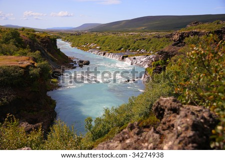Hraunfossar - Icelandic spectacular cascade waterfall - stock photo