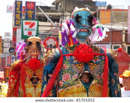 HSINCHU, TAIWAN-AUGUST 14: The puppets in a Ghost Festival parade in Hsinchu, Taiwan on August 14, 2011. Ghost Festival is an important occasion celebrated on the 15th day of the 7th lunar month. - stock photo