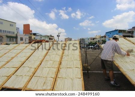 Hsinchu, Taiwan, September 17, 2013 Drying rice vermicelli noodles the traditional way in Taiwan