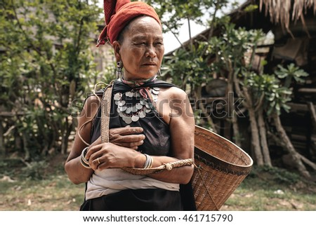 Hta Nee La Len, Myanmar - May 25, 2016: Kayah women from hill tribe in Myanmar. They wear tradition clothes and necklaces made from silver coins.