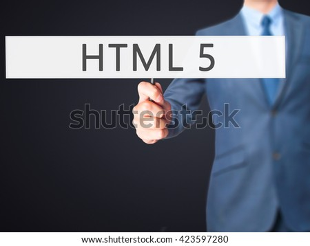 HTML 5 - Businessman hand holding sign. Business, technology, internet concept. Stock Photo - stock photo