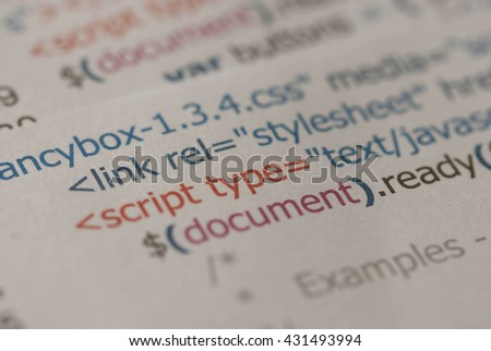 HTML Code.Printed on paper computer code technology background. - stock photo