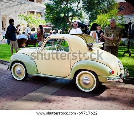 HUA HIN - DECEMBER 18: Fiat Topolino 500C , 1949 year. Retro Car on Vintage Car Parade 2010 at Sofitel Resort on December 18, 2010 in Hua Hin, Thailand. - stock photo