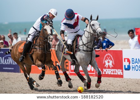 HUA HIN, THAILAND - APRIL 19: France Polo Team (R) plays against Thai Polo Team (L) during 2014 Beach Polo Asia Championship on April 19 2014 in Hua Hin, Thailand. France Polo Team wins 2-1. - stock photo