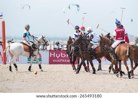 HUA HIN, THAILAND - APRIL 19: France Polo Team (white-red) plays against Thai Polo Team (white-blue) during 2014 Beach Polo Asia Championship on April 19 2014 in Hua Hin, Thailand. - stock photo