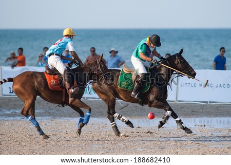 HUA HIN, THAILAND - APRIL 21: Macau Polo Team (R) plays against Thai Polo Team (L) during 2013 Beach Polo Asia Championship on April 21 2013 in Hua Hin, Thailand. Thai Polo Team wins 5-2. - stock photo