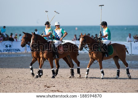 HUA HIN, THAILAND - APRIL 21: Macua Polo Team (green) gets ready for game against Thai Polo Team during 2013 Beach Polo Asia Championship on April 21 2013 in Hua Hin Thailand. Thai Polo Team wins 5-2. - stock photo