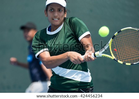 HUA HIN, THAILAND-APRIL 12:Sara Mansoor of Pakistan returns a ball during Day 2 of Fed Cup by BNP Paribas on April 12, 2016 at True Arena Hua Hin in Hua Hin, Thailand