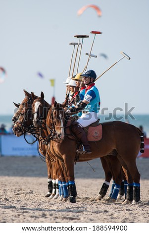HUA HIN, THAILAND - APRIL 21: Thai Polo Team (blue) gets ready for game against Thai Polo Team during 2013 Beach Polo Asia Championship on April 21 2013 in Hua Hin, Thailand. Thai Polo Team wins 5-2. - stock photo