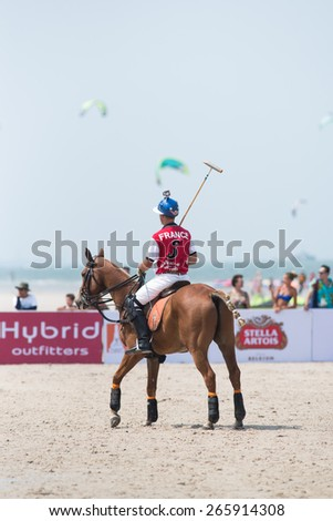 HUA HIN, THAILAND - APRIL 19: Unidentified player of France Polo Team in action during 2014 Beach Polo Asia Championship on April 19 2014 in Hua Hin, Thailand. - stock photo