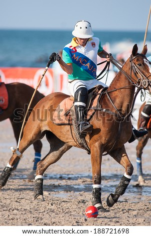 HUA HIN, THAILAND - APRIL 21: Unidentified player of Macau Polo Team in action during 2013 Beach Polo Asia Championship on April 21 2013 in Hua Hin, Thailand. - stock photo
