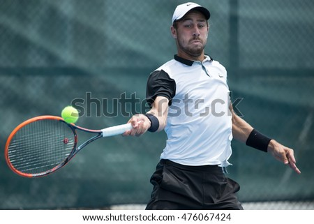 HUA HIN, THAILAND-AUGUST 22:Calum Puttergill of Australia returns a ball during Day 1 of ITF Pro Circuit Thailand Men's F1 on August 22, 2016 at True Arena Hua Hin in Hua Hin, Thailand
