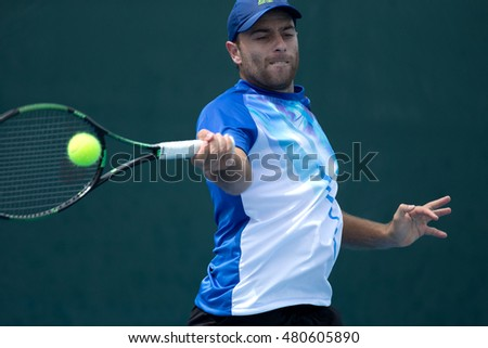 HUA HIN, THAILAND-AUGUST 25:Thales Turini of Brazil returns a ball during Day 4 of ITF Pro Circuit Thailand Men's F1 on August 25, 2016 at True Arena Hua Hin in Hua Hin, Thailand