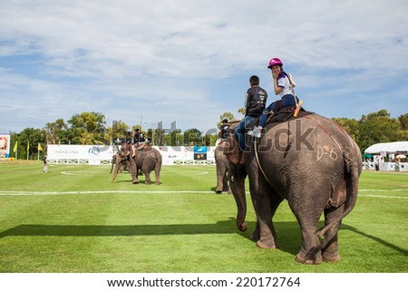 HUA HIN, THAILAND - AUGUST 28: Unidentified polo players at  elephant polo games during the 2013 King 's Cup Elephant Polo match on August 28, 2013 at Suriyothai Camp in Hua Hin, Thailand. - stock photo