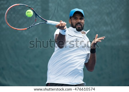 HUA HIN, THAILAND-AUGUST 23:Vishnu Vardhan of India returns a ball during Day 2 of ITF Pro Circuit Thailand Men's F1 on August 23, 2016 at True Arena Hua Hin in Hua Hin, Thailand