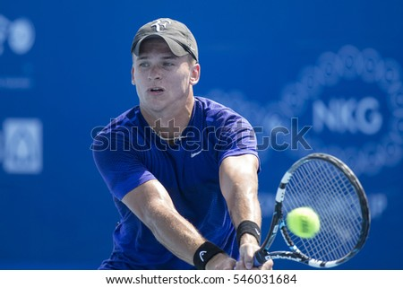 HUA HIN, THAILAND-DECEMBER 27:Danila Arsenov of Russia returns a ball during Day 2 of ITF Pro Circuit Thailand Men's F6 on December 27, 2016 at True Arena Hua Hin in Hua Hin, Thailand