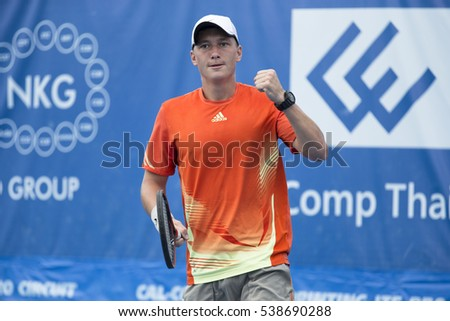 HUA HIN, THAILAND-DECEMBER 14:Denis Yevseyev of Kazakhstan reacts after winning point during Day 3 of ITF Pro Circuit Thailand Men's F4 on December 14, 2016 at True Arena Hua Hin in Hua Hin, Thailand