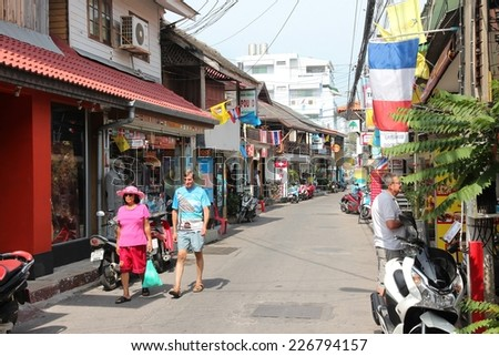 HUA HIN, THAILAND - DECEMBER 14, 2013: People walk the street in seaside resort of Hua Hin. 26.7 million people visited Thailand in 2013.