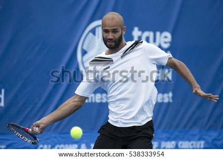HUA HIN, THAILAND-DECEMBER 14:Sadio Doumbia of France returns a ball during Day 3 of ITF Pro Circuit Thailand Men's F4 on December 14, 2016 at True Arena Hua Hin in Hua Hin, Thailand