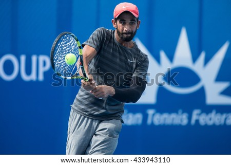 HUA HIN, THAILAND-JUNE 7:Aditya Deswal of India returns a ball during Day 2 of The Qaunt Group ATT Thailand M3 on June 7, 2016 at True Arena Hua Hin in Hua Hin, Thailand