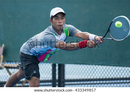 HUA HIN, THAILAND-JUNE 7:Nawakarn Khunjan of Thailand returns a ball during Day 2 of The Quant Group ATT Thailand M3 on June 7, 2016 at True Arena Hua Hin in Hua Hin, Thailand
