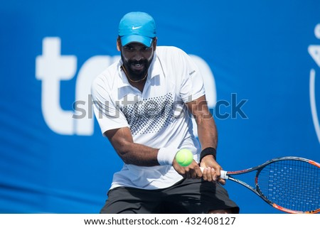 HUA HIN, THAILAND-JUNE 6:Vishnu Vardhan of India returns a ball during Day 1 of The Quant Group ATT Thailand M3 on June 6, 2016 at True Arena Hua Hin in Hua Hin, Thailand