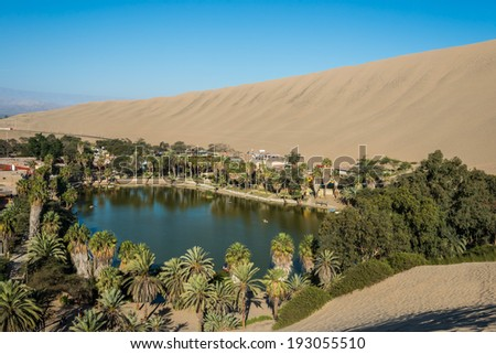 Huacachina lagoon in the peruvian coast at Ica Peru - stock photo