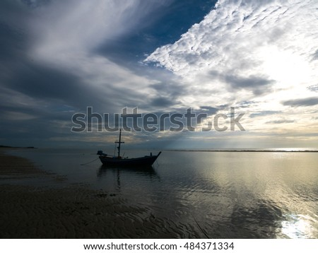 HUAHIN THAILAND : fishing boat seascape with wonderful cloud on sunrise time