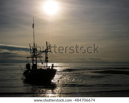HUAHIN THAILAND : silhouette fishing boat on sunrise