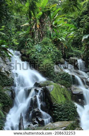 Huay Kaew Waterfall, Paradise waterfall in Tropical rain forest of Thailand , deep forest water fall in Chaingrai