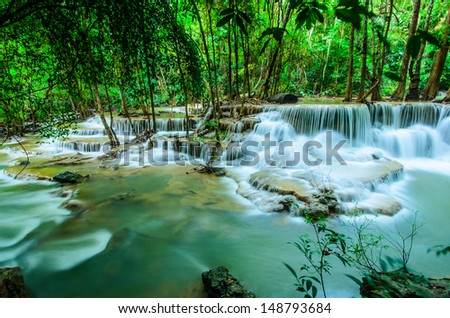 Huay Mae Khamin, Paradise Waterfall located in deep forest of Thailand. Huay Mae Khamin - Waterfall is so beautiful of waterfall in Thailand, Huay Mae Khamin National Park, Kanchanaburi, Thailand. - stock photo