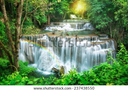 Huay Mae Khamin waterfall with rainbow in deep forest of national park, Thailand  - stock photo