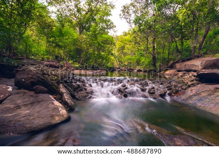 Huay Tha Long small waterfall in tropical forest,Ubon Ratchathani,Thailand,leaf moving low speed shutter blur