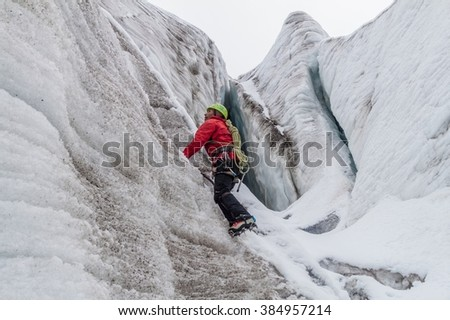 HUAYNA POTOSI, BOLIVIA - APRIL 25, 2015: Local mountain guide climbing the glacier at Huayna Potosi mountain, Bolivia