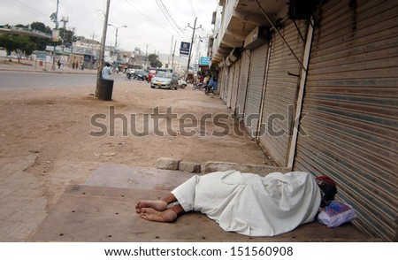 HUB, PAKISTAN - AUG 26: Shops are seen closed during strike called by  (JWP) on occasion of seventh death anniversary of Bugti tribe leader, Nawab Akbar Bugti on August 26, 2013  in Hub.