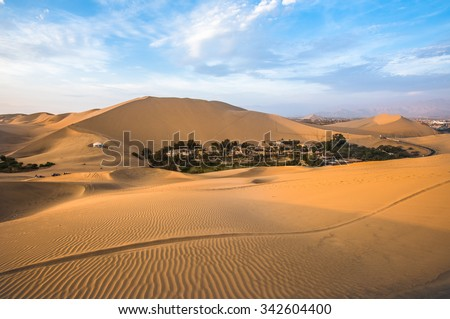 Hucachina oasis in sand dunes near Ica, Peru - stock photo