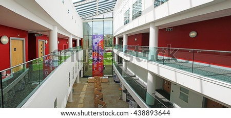 HUDDERSFIELD, UK - JUNE 18 2016: Atrium of the Creative Arts Building, Huddersfield University, a purpose-built, state-of-the-art facility which opened in July 2008 - stock photo