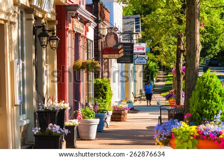 HUDSON, OH - JUNE 14, 2014: Quaint shops and businesses dating back more than a century line Hudson's Main Street looking north. - stock photo