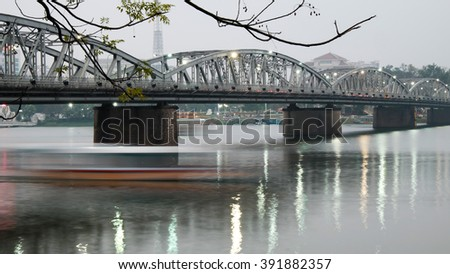 HUE, VIET NAM- FEB 19, 2016: Truong Tien Bridge, cross Huong river, an old bridge link with history, Trang Tien brigde reflect on water, old architect, make from steel, landscape at evening, Vietnam