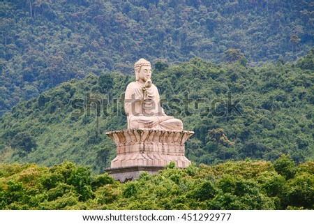 HUE, VIETNAM - CIRCA AUGUST 2013: Buddha statue of Truc Lam Bach Ma Buddhist Temple in the middle of Truoi Lake in Hue (Vietnam)
