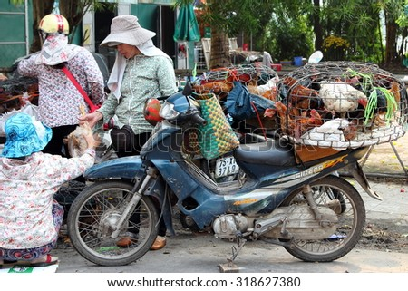 HUE, VIETNAM - MARCH 14, 2015: Vendors selling live stocks at Dong Ba market. - stock photo