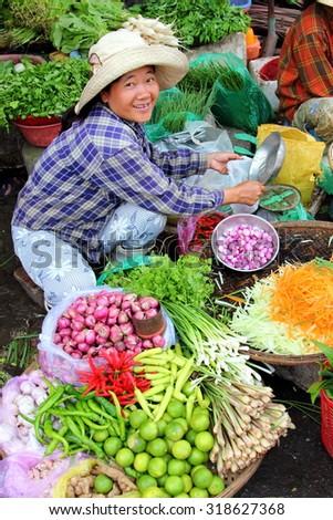 HUE, VIETNAM - MARCH 14, 2015: Vendors selling vegetables at Dong Ba market. - stock photo
