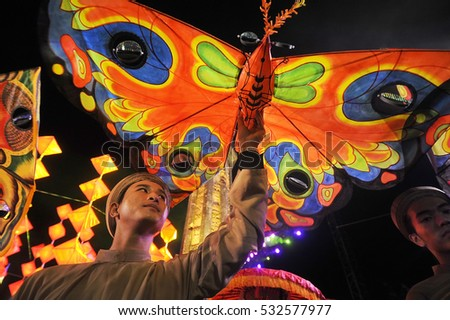 Hue, Vietnam, may 01, 2013:The celebration of Victory Day in the Vietnamese American War, street actors with fabric butterflies in the hands of a street procession, Hue, Vietnam